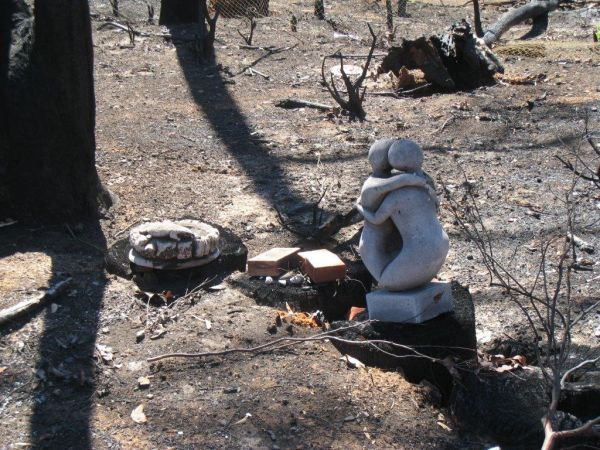 Statue of two figures embracing, on burnt ground