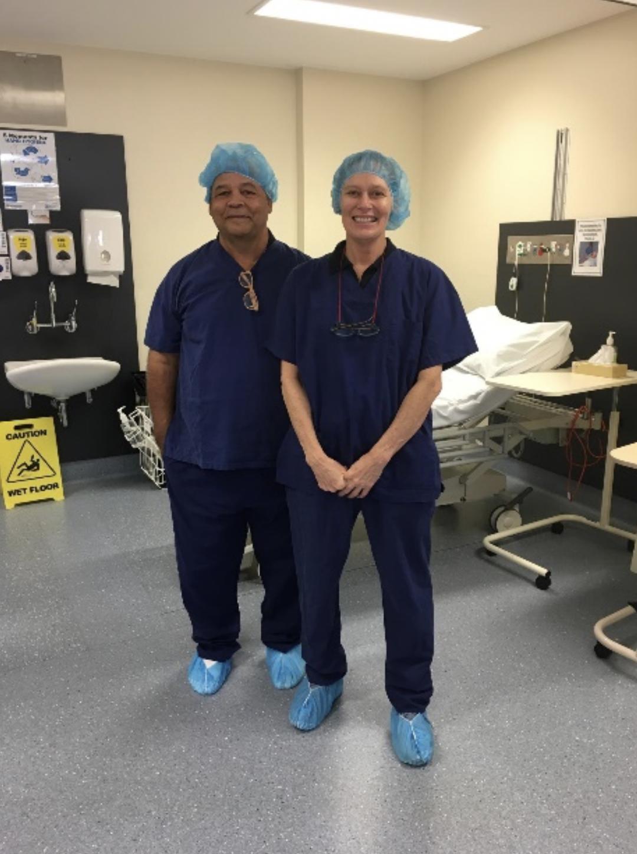 Tania and Patrick wearing scrubs during Wurli Wurlinjang Health Service Intensive Eye Surgery week