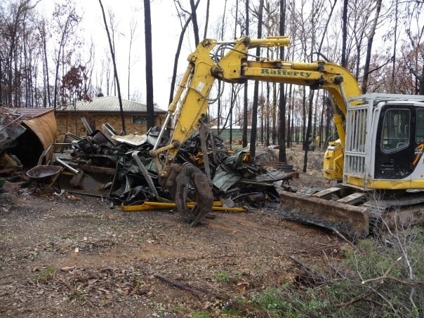Heavy lifting machinery clearing rubble.