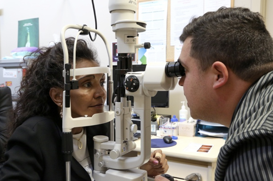 indigenous female have her eye checked