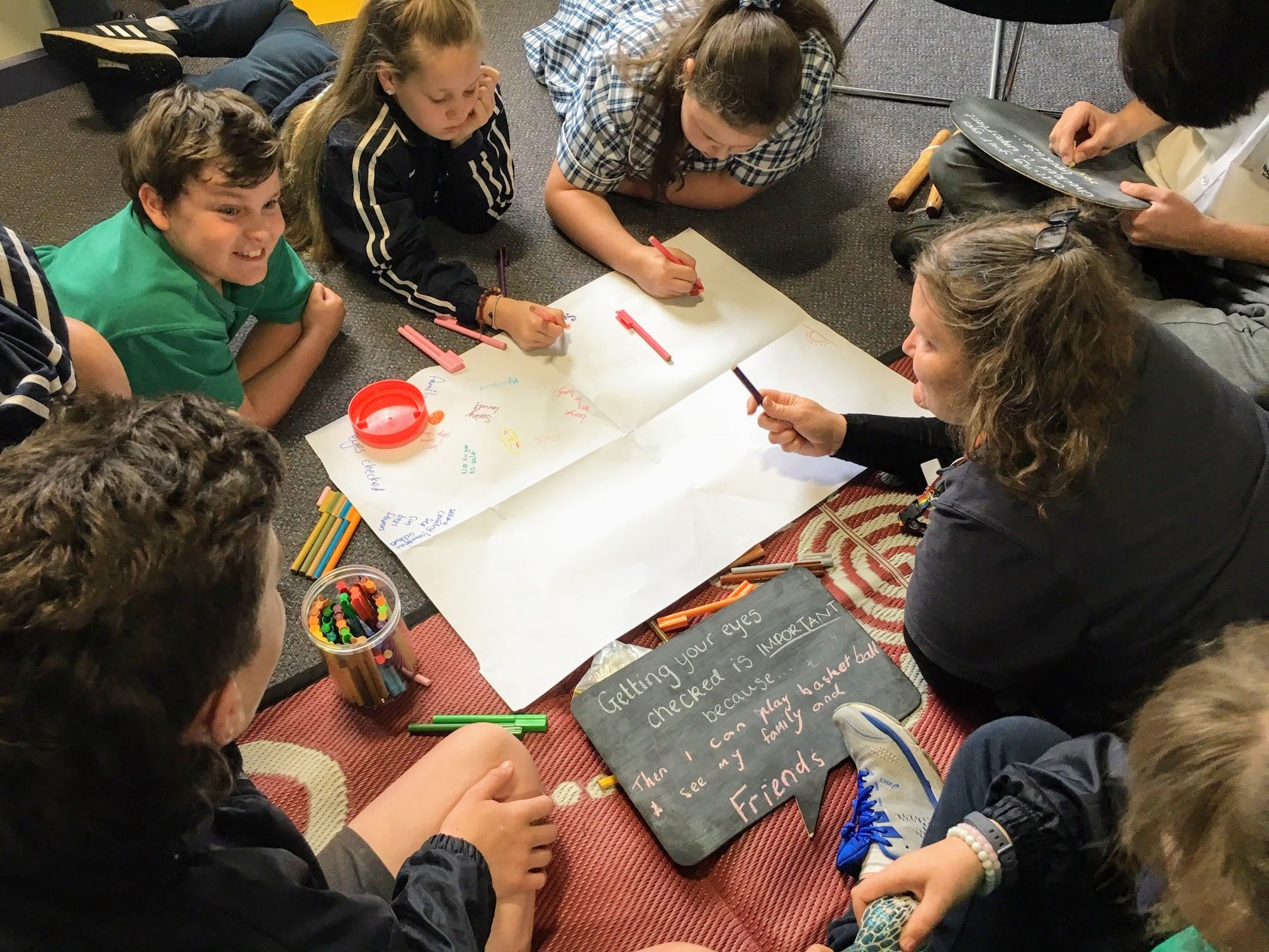 Children designing a poster as part of Cultural Health and Wellbeing Program for Schools