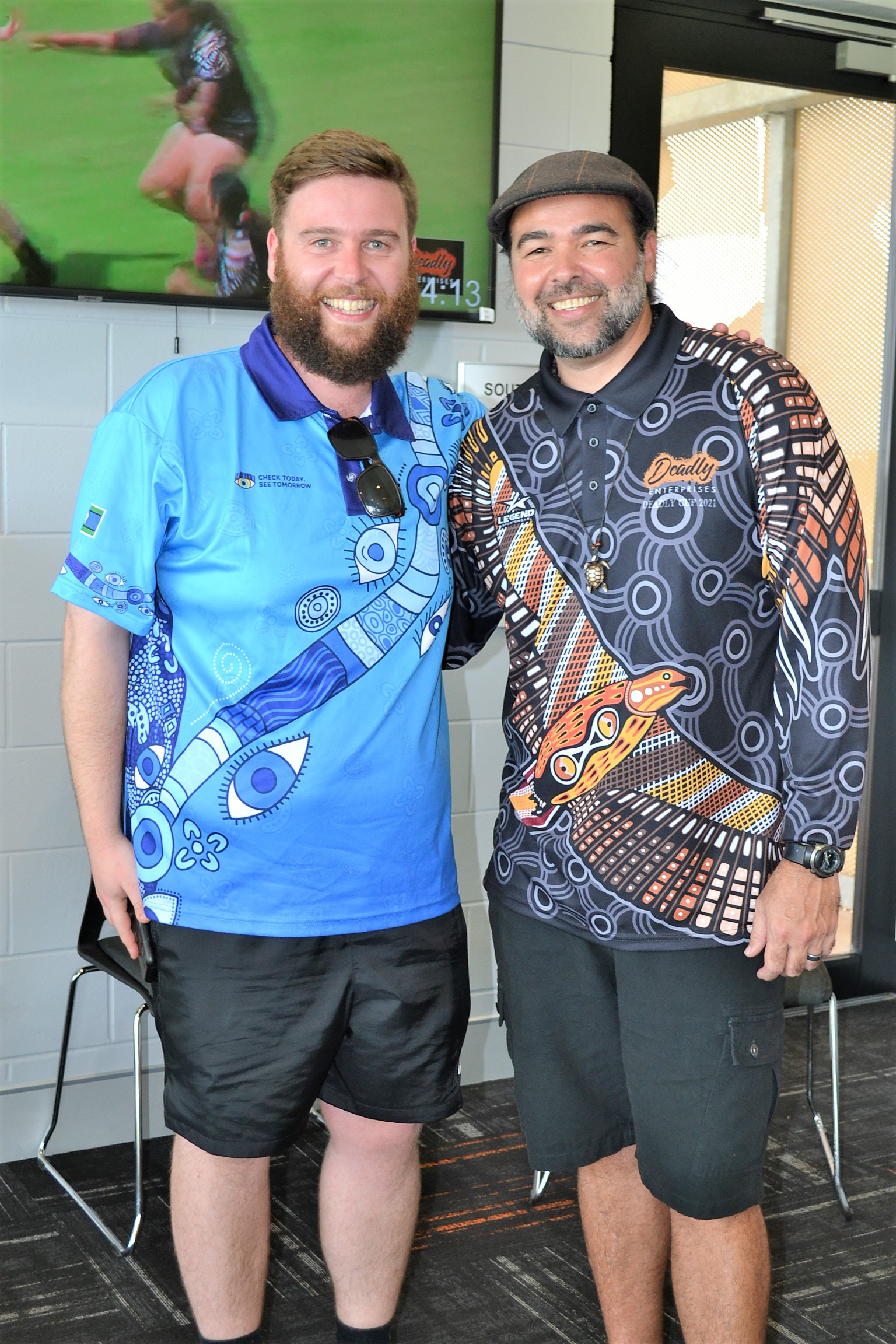 IEH staff at the deadly cup carnival with organiser Shaun Tatipata